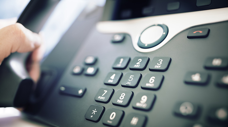 person making call on office VOIP phone