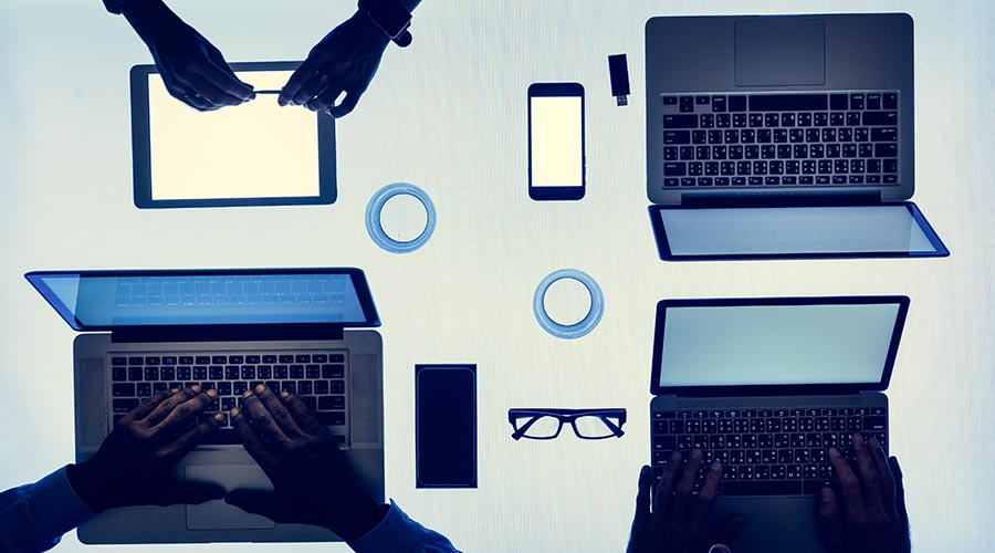 multiple devices laid out across workstation