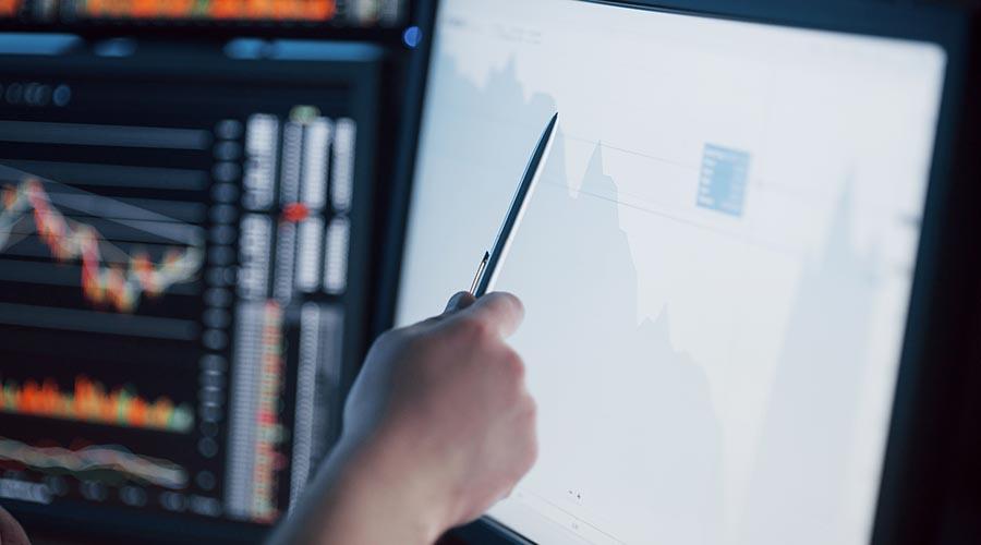 employee analyzing data usage statistics